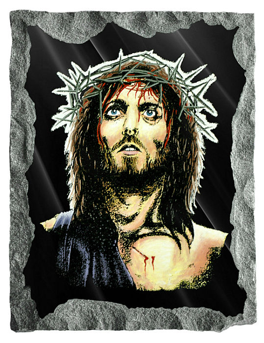 Image of the face of Jesus etched and hand painted in color on black granite.
