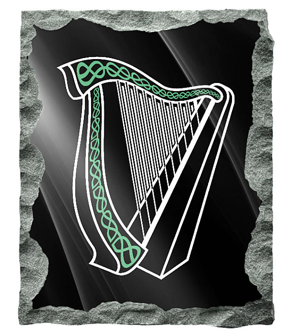Image of Irish Harp memorial etched in silver and green on a black granite background