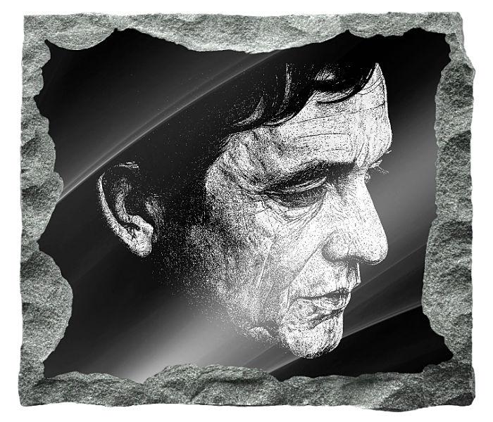 Memorial image of Johnny Cash etched on a black granite background